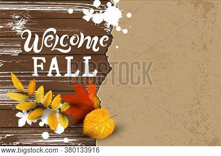 Welcome Fall Hand Drawn Lettering On Dark Wood Background With Falling Leaves, Paper Sheet. Place Fo