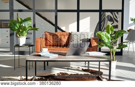 Modern Sunny Living Room Interior Design With Laptop On Home Office Workplace Table, Cozy Sofa Furni