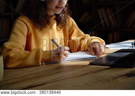 Teen Girl College Student Wear Headphones Studying From Home Writing Notes Watching Webinar Learning