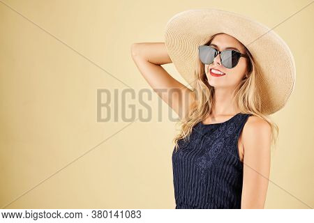 Portrait Of Pretty Smiling Young Blond Woman With Beautiful Toothy Smile Posing In Straw Hat