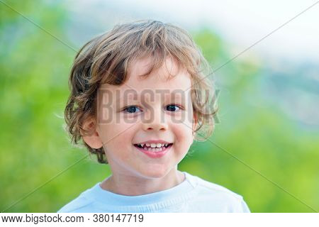 Emotional Kid Walks Outdoors And Enjoy Walking. Portrait Of A Boy Smiling. Has Happy. Funny Boy. Hap