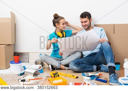 Couple Discussing Home Redesign Ideas. Man And Woman Together Planning New Home Interior Design. Car