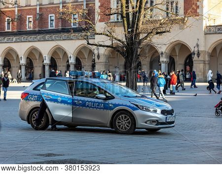 Cracow, Poland - December 10, 2017:  Police Car On Patrol With The Police Sign On Car Hood On Main S