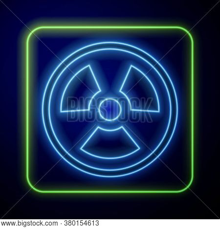 Glowing Neon Radioactive Icon Isolated On Blue Background. Radioactive Toxic Symbol. Radiation Hazar