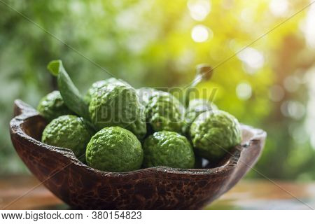 Group Of Bergamot On A Wooden Plate,bergamot On Wooden Basket With Natural Background,