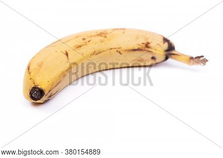 Ripe yellow banana fruit, one overripe banana with dark spots isolated on white background