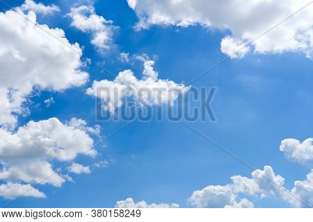 Bright Blue Sky And White Fluffy Clouds High In The Bright Blue Summer Sky On A Day. Good Sunny Weat