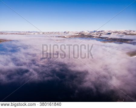 Aerial View. Hardangervidda Mountain Plateau, Norway Landscape. Morning Time, Clouds Over Lake Water