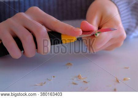 Woman Painter Artist Sharpening Pencil Using Sharp Knife, Hands Closeup. Teacher Sharpen Green Penci