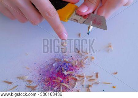 Woman Painter Artist Sharpening Blue Pencil Using Sharp Knife, Hands Closeup. Teacher Sharpen Blue P