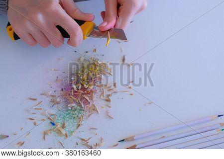 Woman Painter Artist Sharpening Yellow Pencil Using Sharp Knife, Hands Closeup. Teacher Sharpen Blue