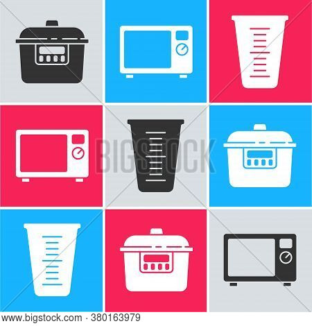 Set Slow Cooker, Microwave Oven And Measuring Cup Icon. Vector