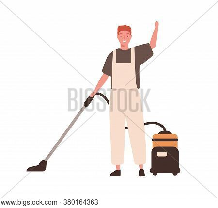 Young Cheerful Man In Office Cleaning Service, Janitor Uniform Vacuuming. Guy Hoover Up Floor With V