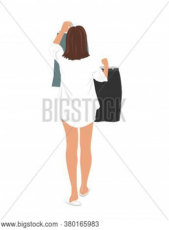 Young Pretty Woman Selecting Clothes To Wear To The Office Work. Girl Holding Up Two Skirts On A Han