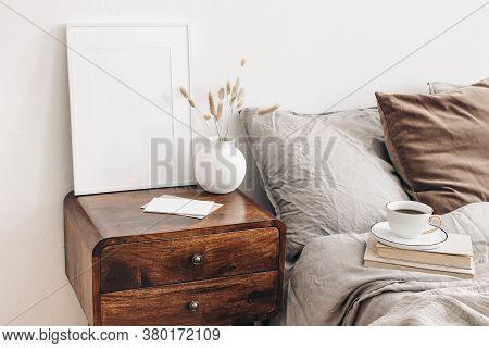 Portrait White Frame Mockup On Retro Wooden Bedside Table. Modern White Ceramic Vase, Dry Lagurus Ov