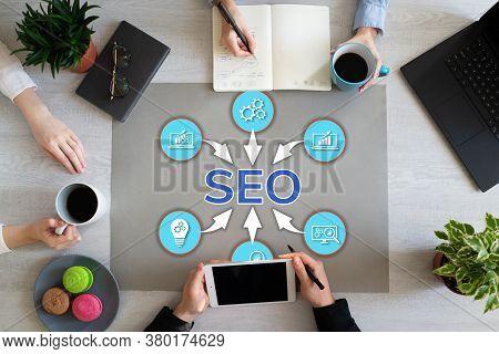 Seo Search Engine Optimisation Digital Marketing Online Advertising Concept On Office Desktop.