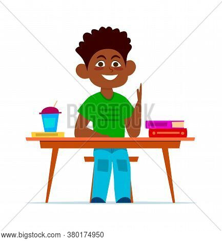 Multiethnic Boy At School Desk In Classroom, Smiling Child Sitting On Chair With Books, Happy Africa