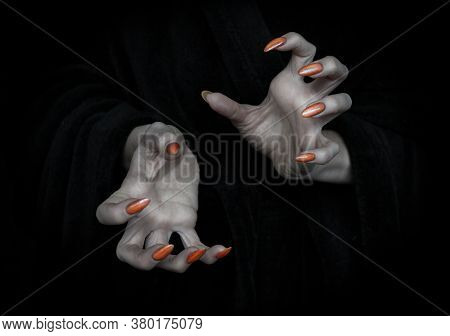 Vampire Hands With Sharp Claws And Knobby Fingers In The Dark, Close Up, Low Key, Selected Focus.