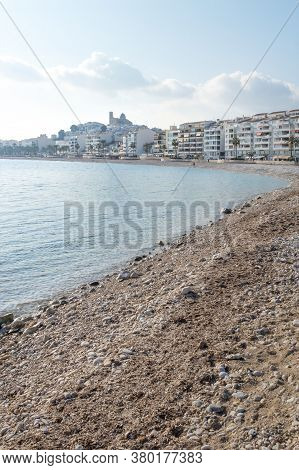 Stone Beach With View On Sunny Altea City Coastline With Church On Top Of The Hill, Costa Blanca, Sp