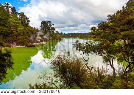 Wai-O-Tapu Geyser Park. Volcanic Valley Waimangu. New Zealand, North Island. Inferno Crater Lake is a large hot spring and bright green water. The concept of exotic, ecological and photo tourism
