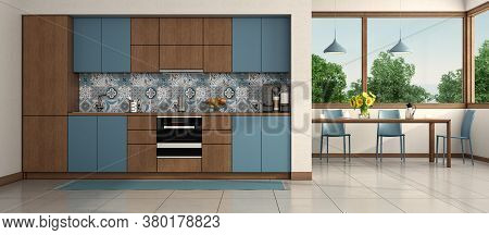 Modern Blue And Wooden Kitchen With Ding Table And Chair On Background - 3d Rendering