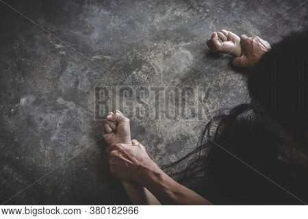 Male Hand Holding A Woman Hand For Rape And Sexual Abuse. Image For Rape And Sexual Abuse Concept. S