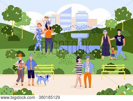Happy Families Rest In The Park On A Summer Or Spring Day At Their Leisure Or On Weekends. A City Pa