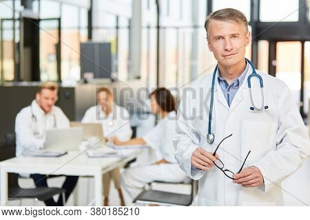 Man as a specialist with competence and experience in front of his medical team in the meeting