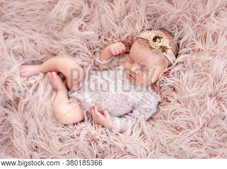 Charming newborn wearing lace suit