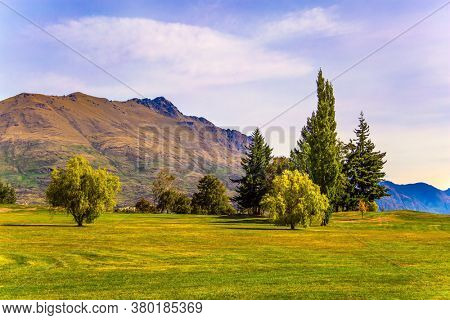 Fantastic trip to the ends of the earth. The surroundings of the city - resort Queenstown. Mountains and meadows. The concept of active, ecological, automotive and photo tourism