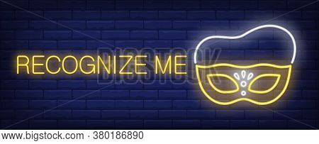 Recognize Me Neon Sign. Glowing Inscription With Yellow Mask On Brick Wall Background