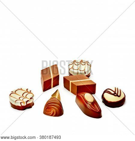 Various Chocolate Pralines Isolated On White Background. Free Space For Text.