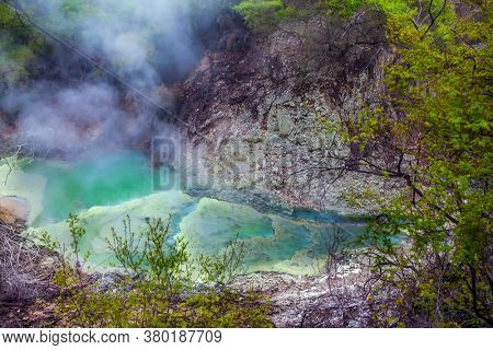 Wai-O-Tapu Geyser Park. Volcanic Valley Waimangu. Inferno Crater Lake is a large hot spring and bright green water. New Zealand, North Island. The concept of exotic, ecological and photo tourism