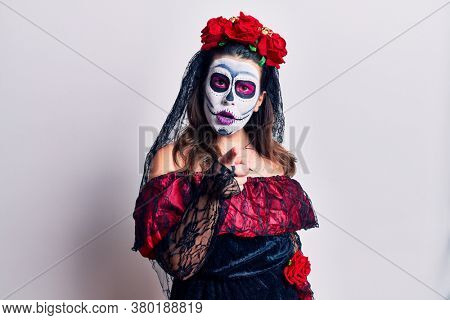 Young woman wearing day of the dead costume over white pointing displeased and frustrated to the camera, angry and furious with you
