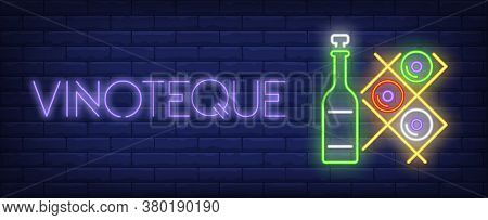 Vinoteque Neon Text With Wine Bottles On Racks. Winery And Wine Collection Design. Night Bright Neon