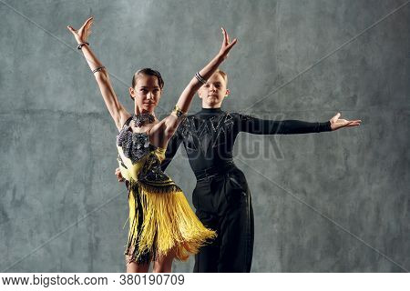 Ballroom Dance Samba. Young Couple In Yellow And Black Costume Dancing.