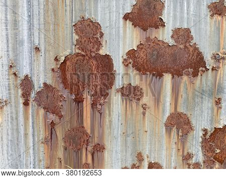 Faded Eroded Close-up Rusted Sheet Metal Siding Steal Wall Suitable For Website Marketing Background