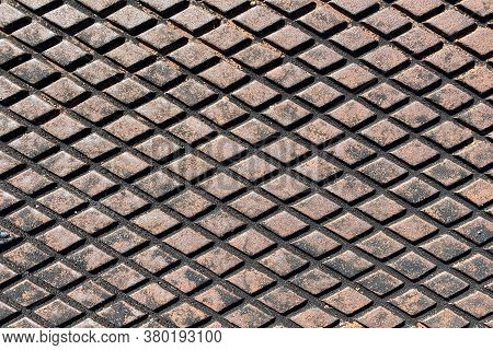 Rusty Retro Wide Angle View Diamond Plate Storm Drain Cover Suitable For Website Marketing Backgroun