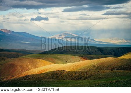 Awesome Vast Landscape With Vivid Multicolor Mountains At Sunset. Scenic View To Colorful Hills And