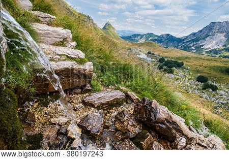 Water Source Near Durmitor Panoramic Road, Sedlo Pass. Picturesque Summer Mountain Landscape Of Durm