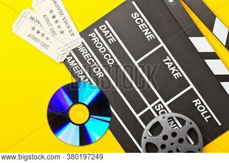 Single, Black, Open Movie Clapper Or Clapper-board With Dvd Movie Disc, Film Reel And Movie Theatre