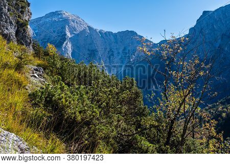 Sunny Idyllic Colorful Autumn Alpine Scene. Peaceful Rocky Mountain View From Hiking Path Near Almse