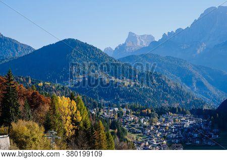 Autumn Alpine Dolomites Scene, Belluno, Sudtirol, Italy. Peaceful Village Falcade And Rocky Mountain