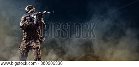 Soldier Of Special Forces Aiming On Target.  Infantryman Fighting With Terrorism. Commando On Smoky