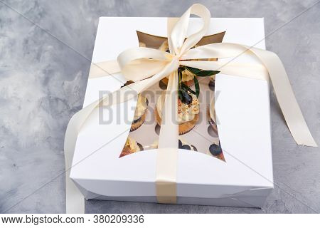 Gift Box With Tasty Cupcakes. Present Box Full Of Fruit Cupcakes. Birthday Party. Easter Or Christma