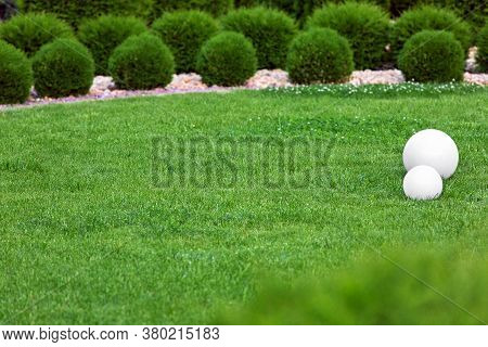 Backyard Lights Garden With 2 Electric Ground Lanterns With Sphere Diffuser Lamps In Meadow In Outdo