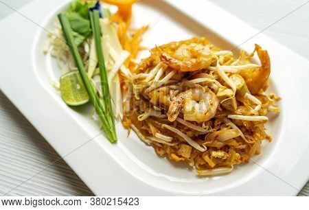 Pad Thai Or Thailand Tradition Stir Fried Noodle. Pad Thai Noodle With Shrimps In White Plate, Veget