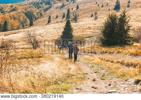 Two Old People Actively Spend Weekends In The Autumn Mountains Go To Hiking