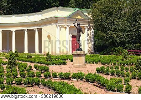 Picturesque Landscape Photo Of The Decorative Architectural Building Called Echo Colonnade And Sculp
