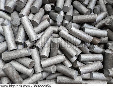 A Pile Of Sand Blasted Stainless Steel Rods - Closeup With Selective Focus